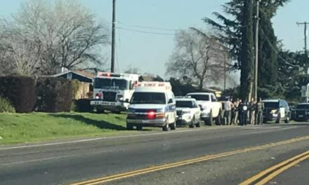 Vehicle drives with man on hood of vehicle in Winton