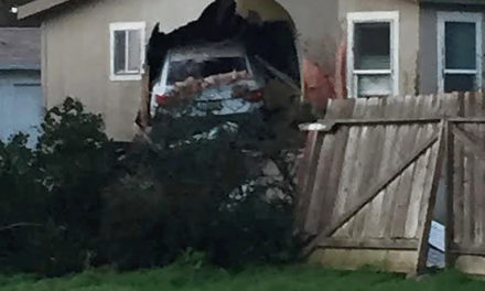 Vehicle crashes into house in Snelling