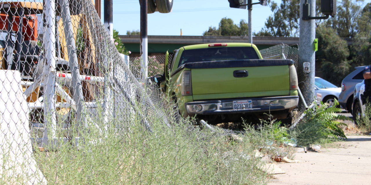 Truck crashes into fence in Atwater