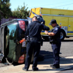 Vehicle overturns next to Foster Freeze in Atwater