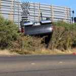 Driver survives after pickup overturns in Merced County