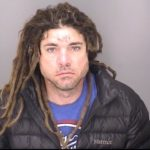 Man arrested for allegedly dragging officer with vehicle
