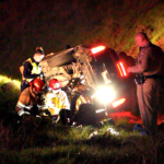 Vehicle lands on side, two injured in Atwater