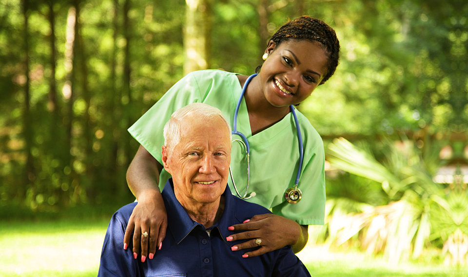 nurse smiling with her senior patient
