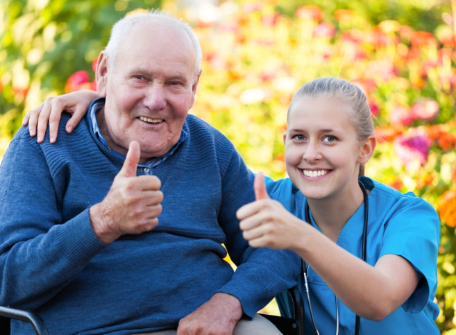senior man and his caregiver giving thumbs up