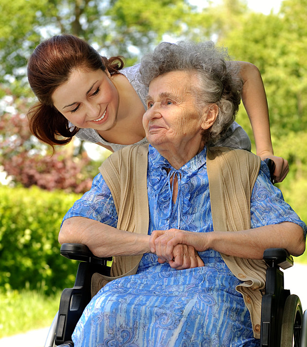 young lady accompanying a senior woman on a wheelchair