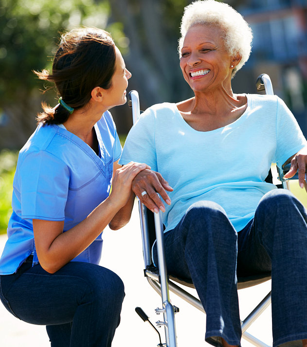 senior woman on a wheelchair together with her caregiver