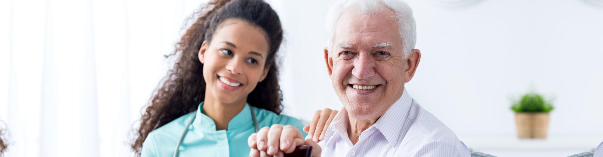 nurse smiling with her senior patient
