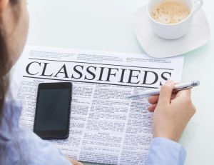 Businesswoman Reading Classifieds