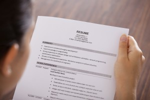 Young Businesswoman Reading Resume