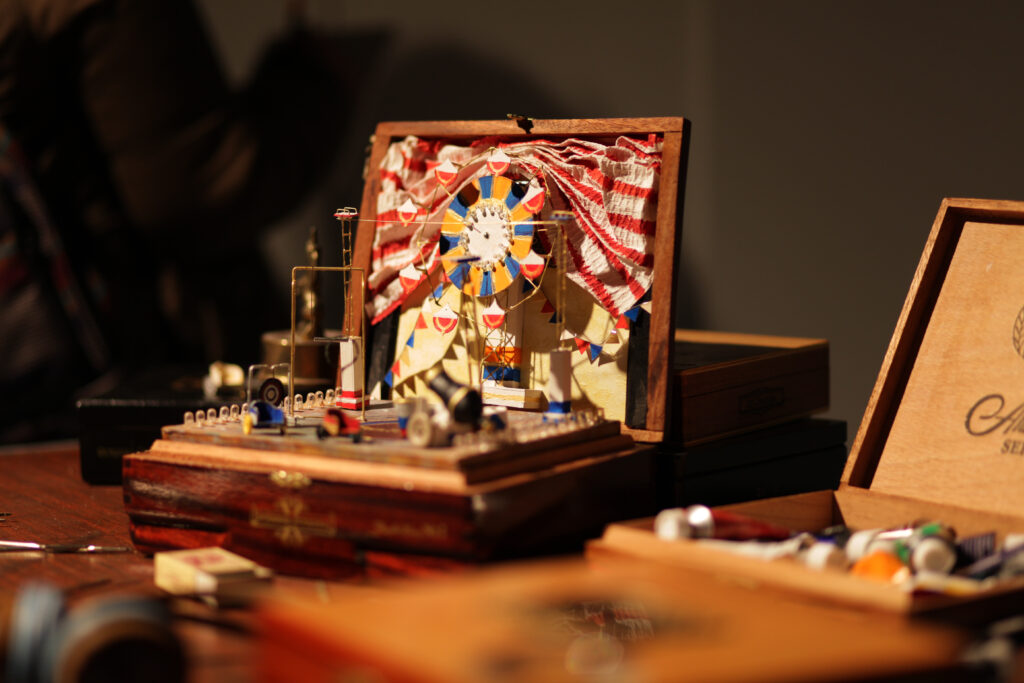 Old cigar box with miniature circus for art installation