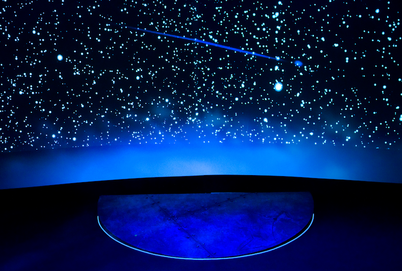 Image of stage with shooting star in background