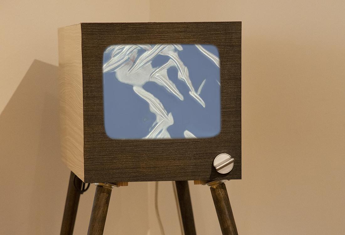 1960's era TV with video of algorithmic wallpaper designs