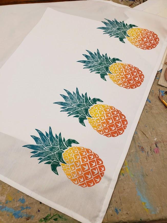 tea towel with pineapples printed on it