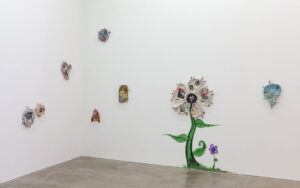 erin jane nelson exhibit of flower and 2D art on wall