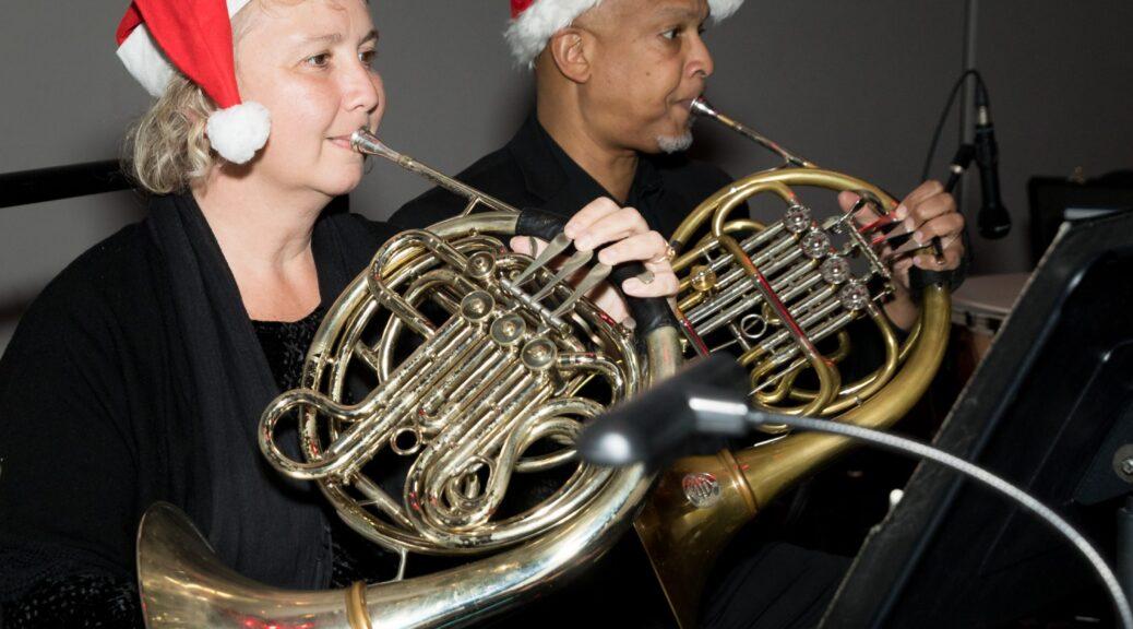 musicians wearing santa hats