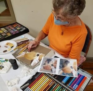 artist working with pastels