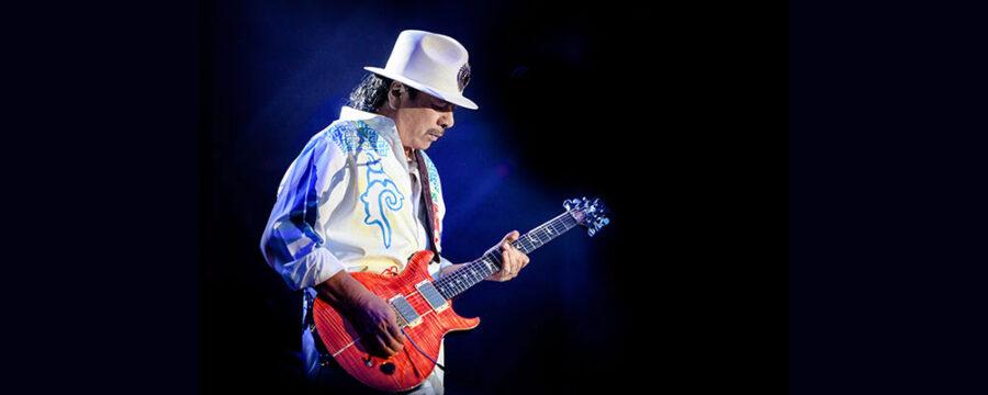 carlos santana playing guitar on stage