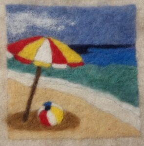 needle felting project of a beach