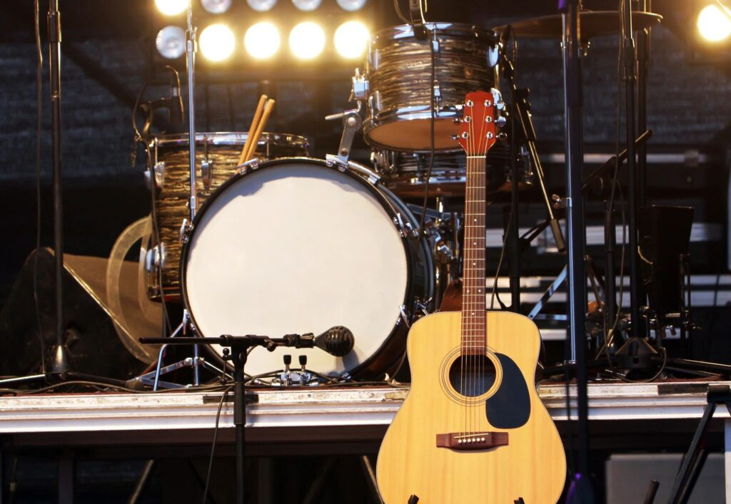 drum and acoustic guitar on stage
