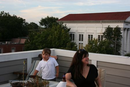 guests enjoying the sunset from the rooftop terrace