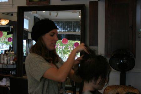 Velvet Salon owner Melissa Pope works a new do
