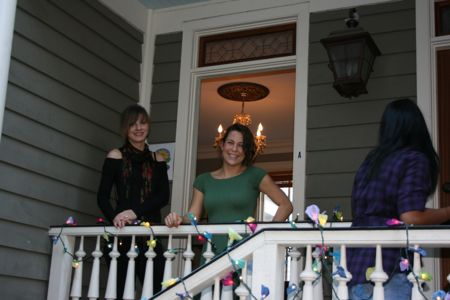 Abigail McClam (center) stands at the entrance of her new massage studio