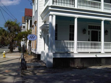 Salon 101 puts up a sign on Spring St, downtown Charleston Sc