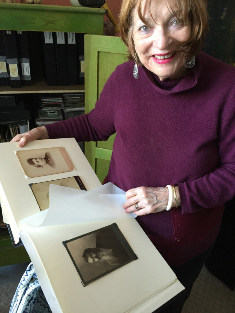 Elaine reviewing photos of ancestors at her San Francisco Studio on Yosemite Street