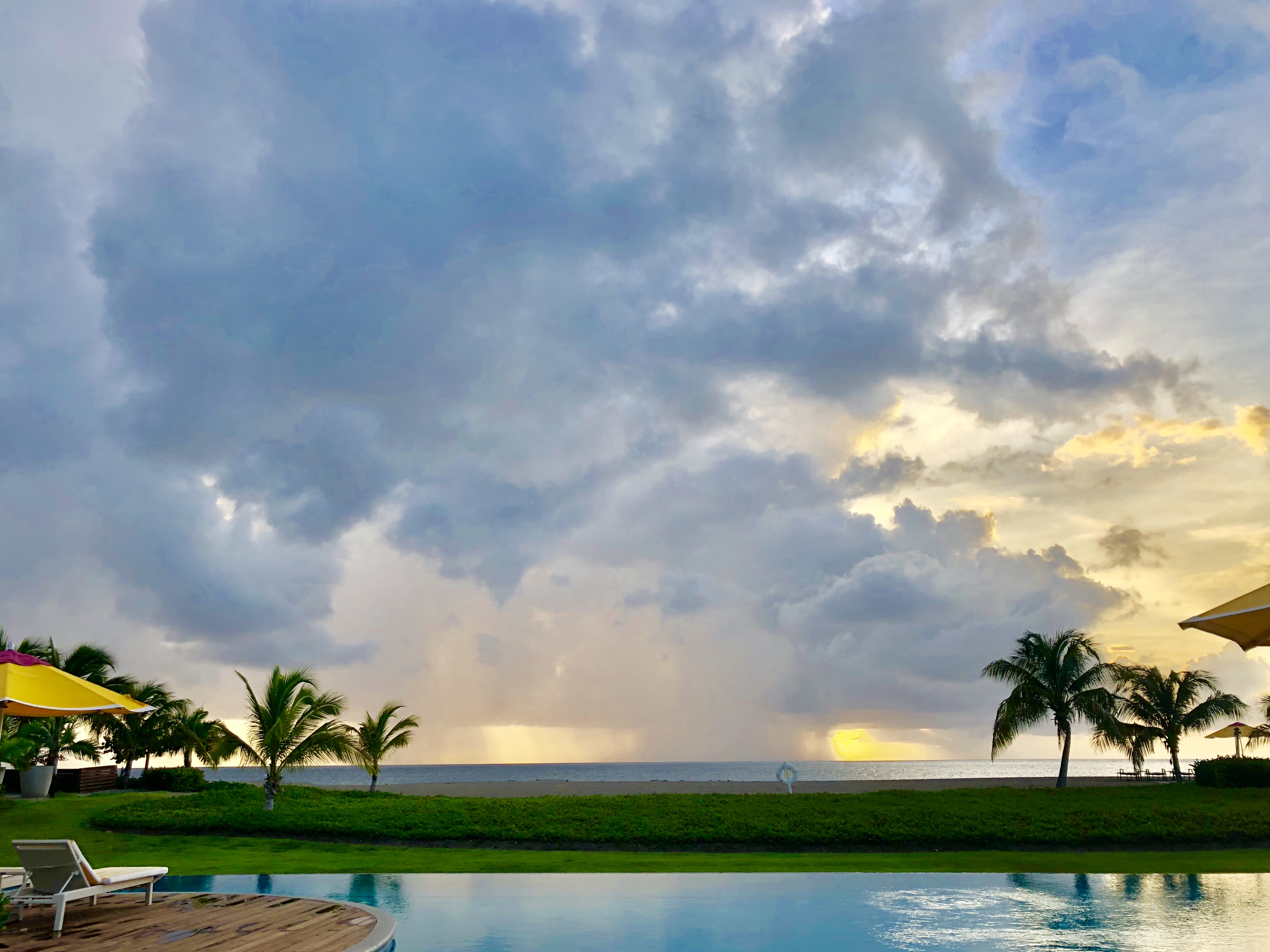 four seasons, four seasons nevis, st. kitts, nevis, caribbean, resort, hotel, ocean, pool, spa, massage, sunset, sky, blue sky