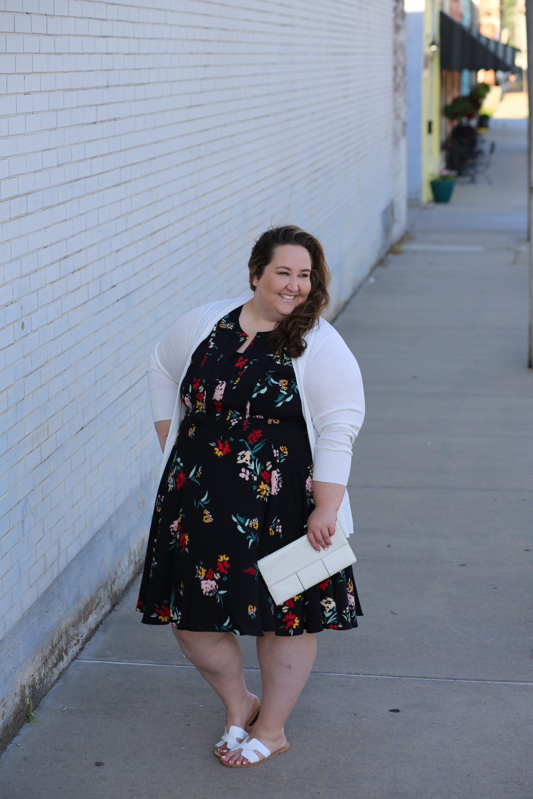 floral dress, plus size style, white cardigan, white clutch, white sandals, dia & co.