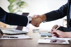 Business handshake for employee screening services