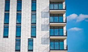 apartment building with blue sky for tenant screening