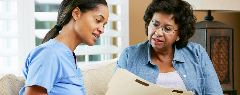 caregiver discussing community member file