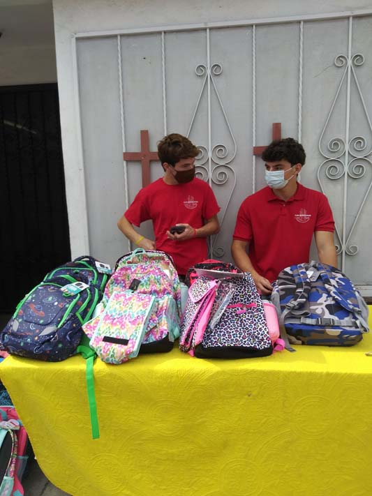 helping with backpacks for school
