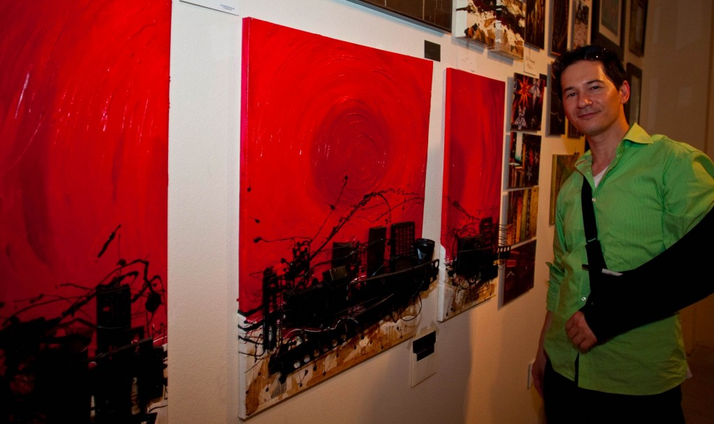 "Mixed media artist Andrew Ko displays his three-dimensional triptych painting entitled ""Dead City Full Trip"" during the Canoga Park ARTrageous Art Walk in Canoga Park, Calif. on July 20, 2012."