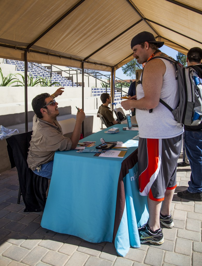 Volunteer David DeLoya, sets an appointment for Dustin Elliott, a youth pastor, who is taking advantage of help offered under Covered California Week, in front of the library of Pierce College. Monday Feb. 24, 2014 Woodland Hills, Calif. Photo: Lynn Levitt.