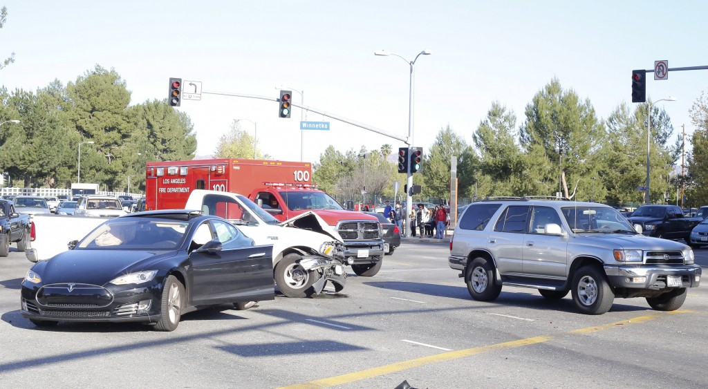 Paramedics on the scene of an accident involving seven cars at the intersection of Victory and Winnetka at Pierce College, Woodland Hills, March 12, 2014.