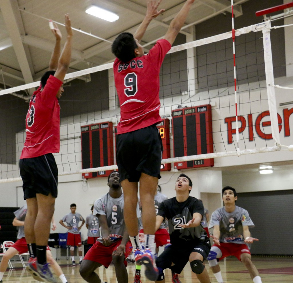 Pierce College plays defense as the Santa Barbara Men's Volleyball team spikes the ball on Wednesday, March 26, 2014 at Pierce College in Woodland Hills Calif. Photo: Giuliana Orlandoni