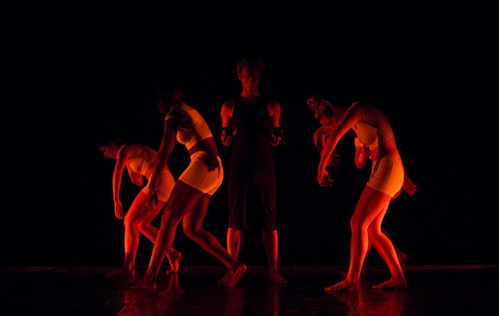 """William Jace stands in the center of other dancers during a performance of a dance titled """"Diptych"""" during the 2014 Spring Dance Concert, Montage, in the Performance Tent of Pierce College in Woodland Hills, Calif., on May 29, 2014. Photo: Nicolas Heredia"""