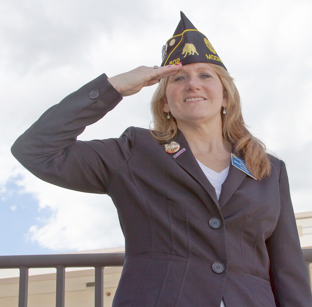 Barbara Lombrano, 2 year of business managament, is the first woman to lead the Moorpark Post of the American Legion smiles to the camera, at Pierce College in Woodland Hills Calif, on Sept 18, 2014. photo by Erick Ceron.