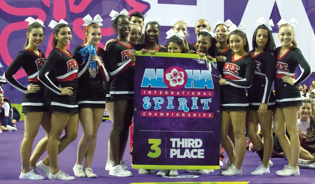 Pierce College's cheerleading competition team holds up its third place banner after competing against California Baptist University and USC on Saturday, March 14 at USC. Photo by: Alan Castro