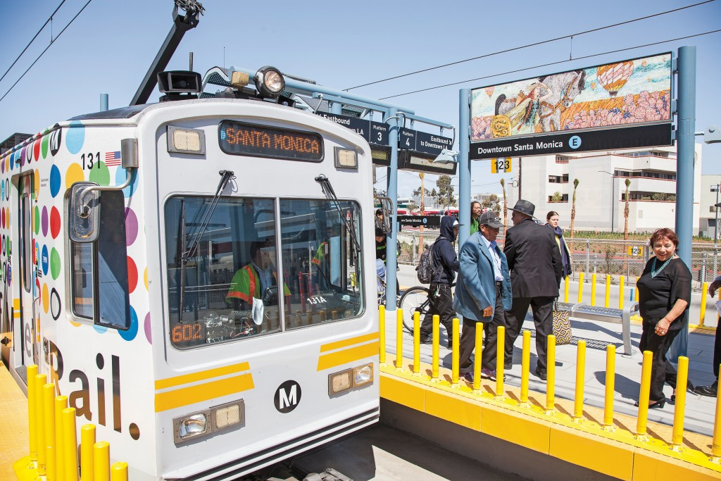 Riders exit the newly opened Expo Line at the Downtown Santa Monica station on Monday, May 23. The Expo Line connects at the 7th Street Metro Station and allows people living in the San Fernando Valley to visit Santa Monica using light rail. Photo: Mohammad Djauhari