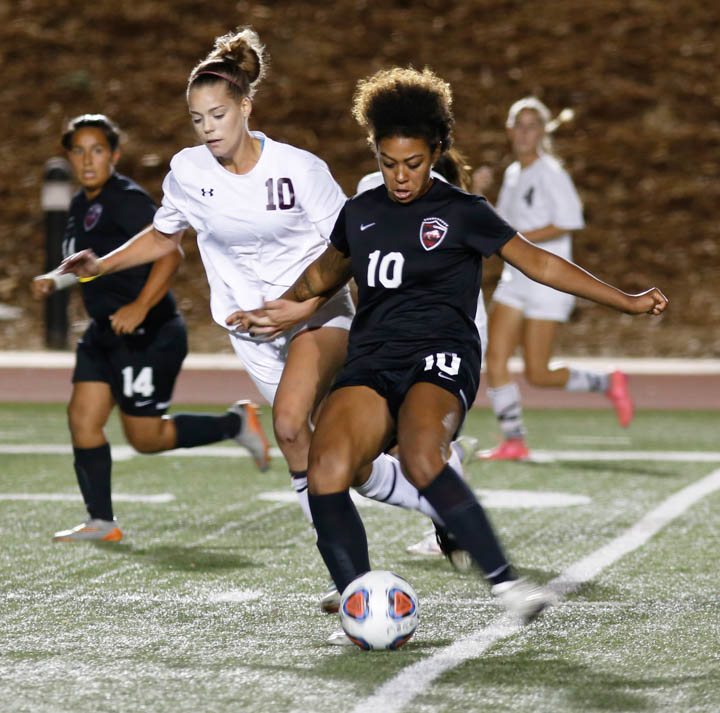 Soccer game between Pierce College and Victor Valley College, Pierce College win score is 2-1, Leslie Ramirez is number 10 attack from Pierce College right Jordan Hemstedt is number 10 defense from Valley College, on football field, Pierce College, on Saturday Sep 30 2016, Woodland Hills, Clifa., photo by Abdolreza Rastegarrazi/Roundup