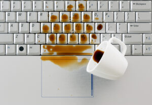 Spilled drink on computer keyboard