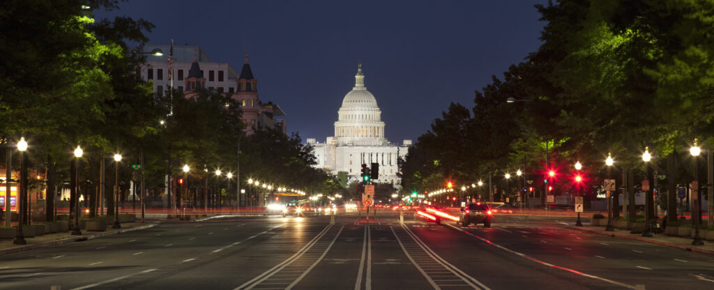 US Capitol and Constitution Avenue in Washington DC at night