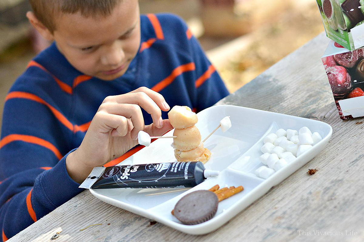 Picture of child assembling edible ice cream snowmen with perfectlyfree® bites