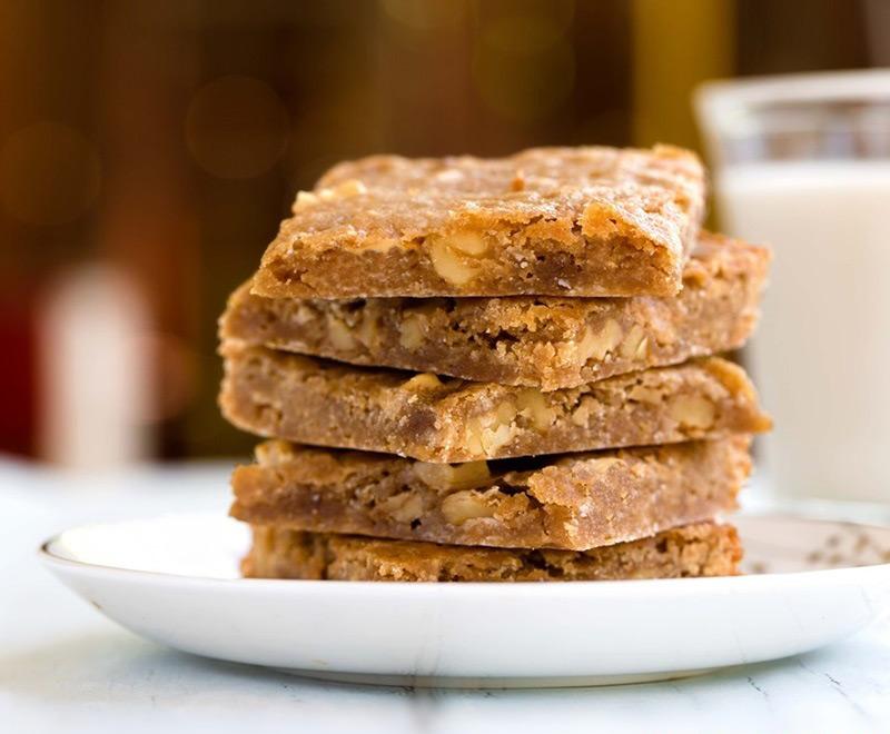 Stack of vegan salted caramel cafe blondies
