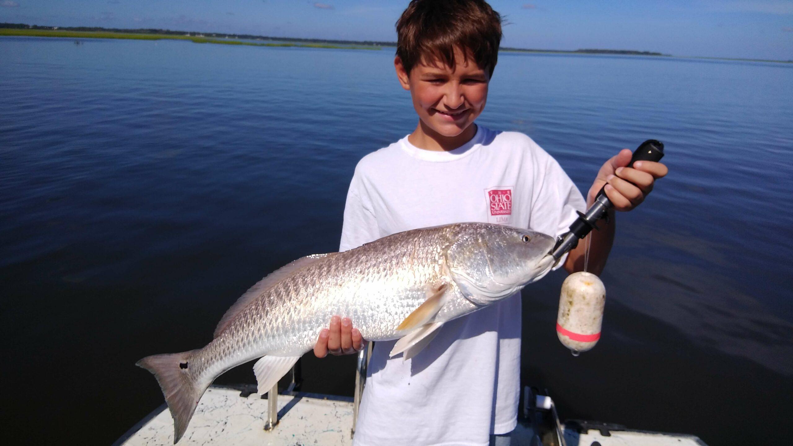 Happy kid with redfish