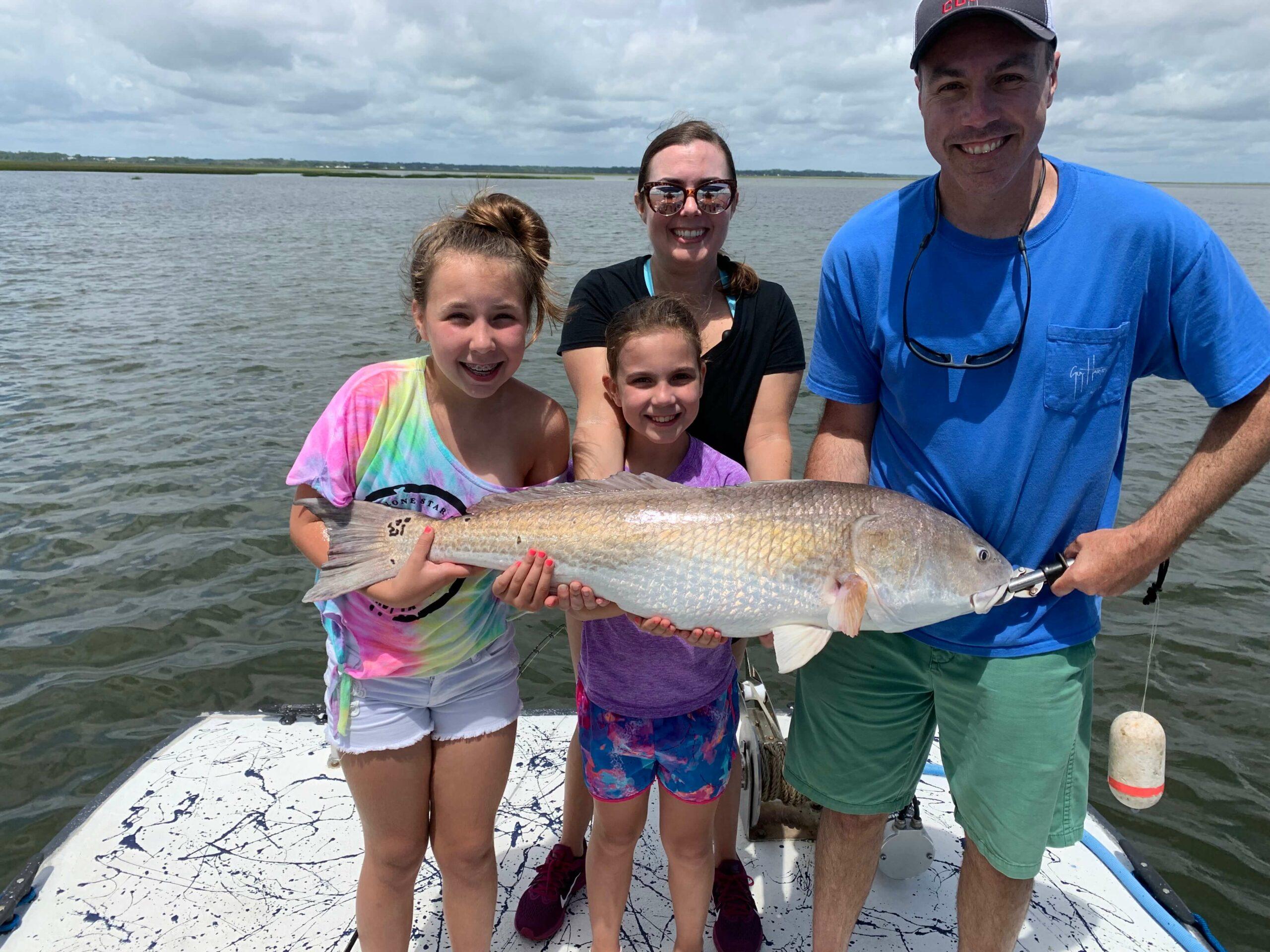 happy family fishing on Amelia Island Charters